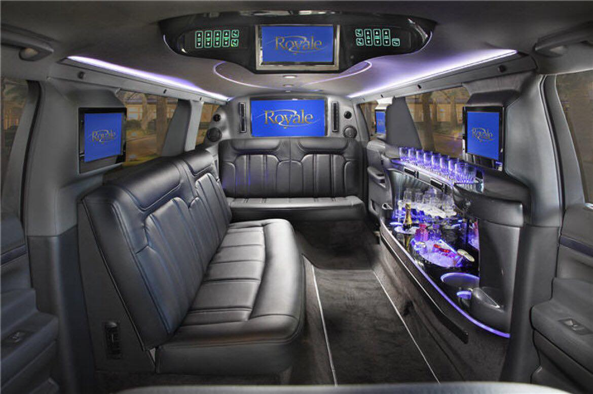 Inside a white limo party bus